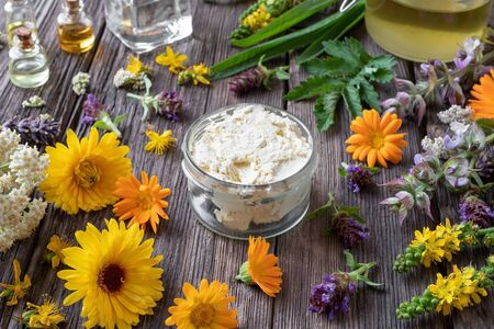 Homemade skin cream made from shea butter, medicinal herbs and essential oils