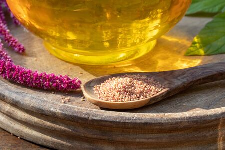 Amaranthus caudatus seeds on a spoon, with oil in the background Stok Fotoğraf