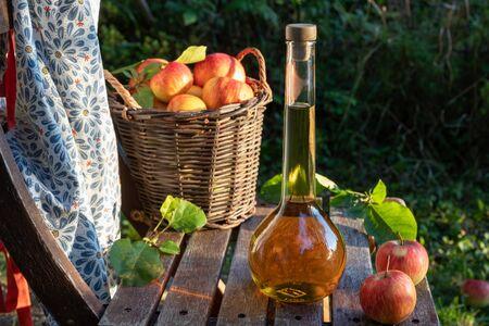 Apple cider vinegar with ripe apples, outdoors Stok Fotoğraf