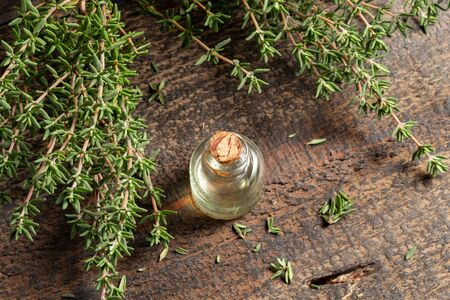 A bottle of essential oil with fresh thyme twigs Stock fotó