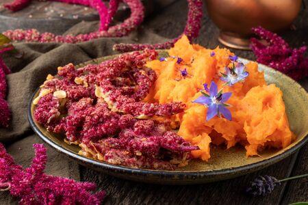 Amaranthus caudatus flowers fried in a batter, with sweet potato puree Stok Fotoğraf