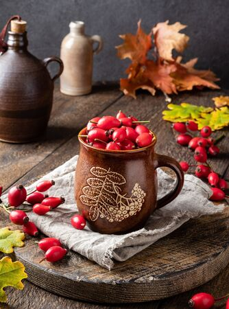Still life with rose hips and autumn leaves Stock fotó