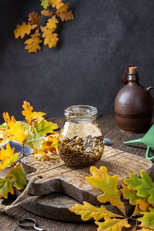 Preparation of a homemade herbal tincture from oak bark in a glass jar