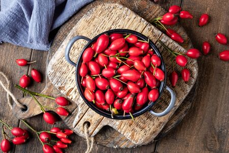Fresh rose hips on a table, top view Stock fotó