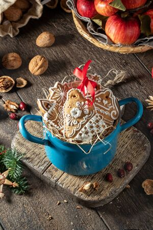 Christmas gingerbread cookies in a blue pot on a table Banco de Imagens