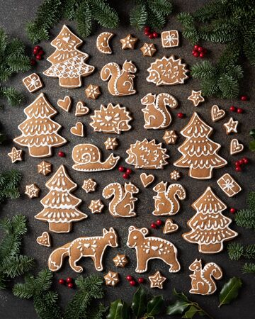 Homemade Christmas gingerbread cookies on a dark background, top view