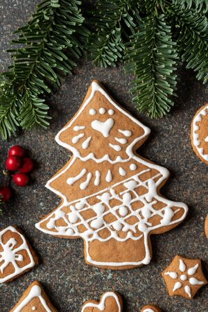 Homemade Christmas gingerbread cookie in the form of a tree on a dark background, top view Banco de Imagens