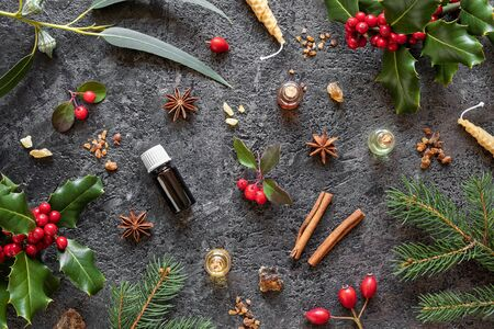 Christmas selection of essential oils with myrrh, frankincense, wintergreen, holly and winter spices