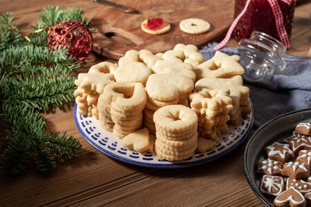 A pile of fresh Linzer Christmas cookies, ready to be filled with red currant marmalade