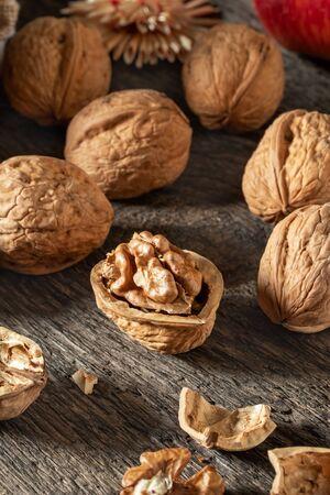 Closeup of whole and broken walnuts