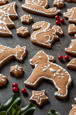 Homemade Christmas gingerbread cookies on a dark background