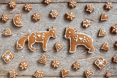 Homemade Christmas gingerbread cookies in the form of forest animals and stars, top view