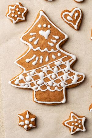 Homemade Christmas gingerbread cookie in the form of a tree, top view