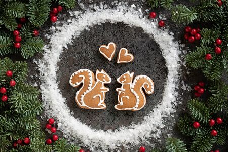 Homemade Christmas gingerbread cookie in the form of two squirrels and hearts Stock fotó