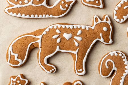 Homemade Christmas gingerbread cookies on parchment paper, top view