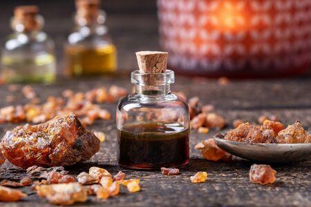 Myrrh essential oil and resin on a table