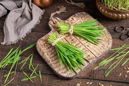Homegrown barley grass blades on a cutting board
