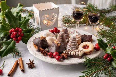 Beehives or wasp nests, vanilla crescents and other typical Czech Christmas cookies on a white plate Reklamní fotografie