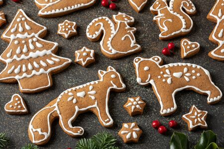 Gingerbread cookies in the shape of forest animals and trees Archivio Fotografico