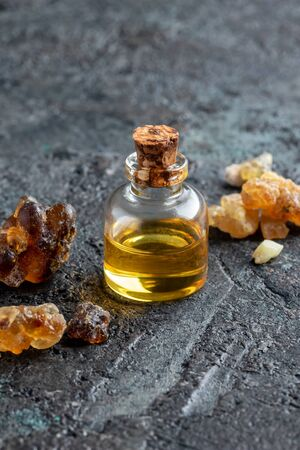 A bottle of frankincense essential oil and resin, with copy space Stock Photo