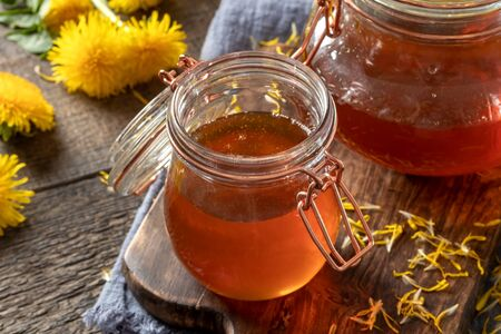 A jar of dandelion honey - a syrup made from fresh Taraxacum flowers