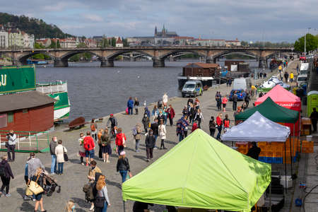 PRAGUE, CZECH REPUBLIC - APRIL 25, 2020: Naplavka farmers market, re-opened for the first time since the coronavirus outbreak. People are wearing face masks and keeping distance. Redakční