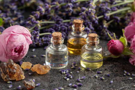 Bottles of essential oil with frankincense, rose and lavender