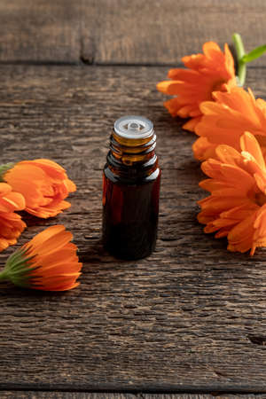 A bottle of calendula essential oil on a table