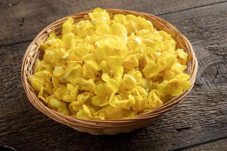 Fresh denseflower mullein flowers in a wicker basket on a table