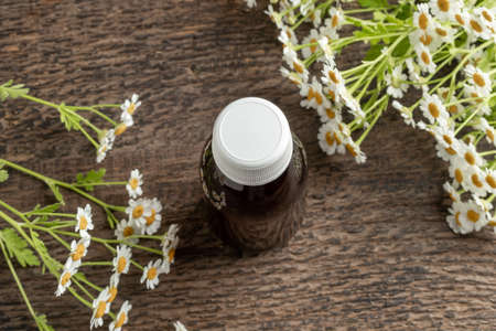 A bottle of feverfew tincture on a table