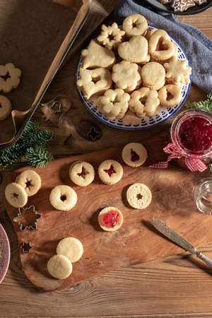 Filling traditional Linzer Christmas cookies with marmalade, top view