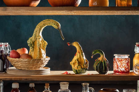 Gourds in the form of geese or swan in the storeroom - goslings have eaten all the marmalade