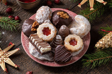Beehives or wasp nests, vanilla crescents, Linzer and various Czech Christmas cookies on a plate