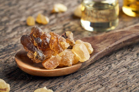 Frankincense resin on a wooden spoon on a table, closeup