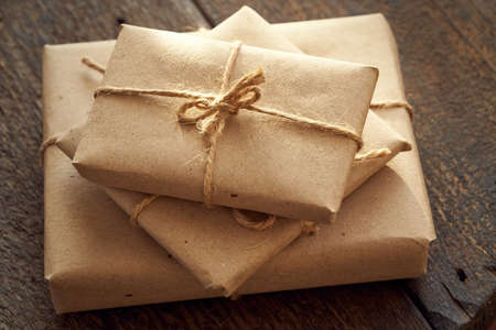 Christmas presents wrapped in ecological recycled paper, close up Reklamní fotografie