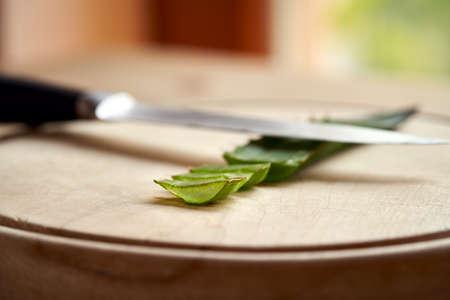 Sliced fresh aloe vera leaf on a cutting board Stock Photo