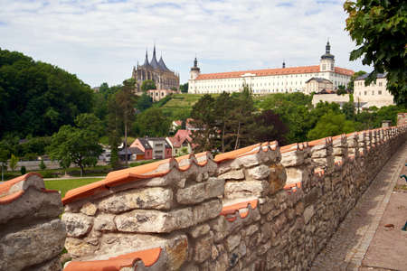KUTNA HORA, CZECH REPUBLIC - JUNE 5, 2021: Town walls with St. Barbara's Cathedral and the Jesuit College in the background