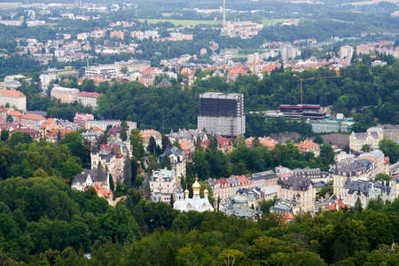 KARLOVY VARY, CZECH REPUBLIC - AUGUST 20, 2021: View of the spa town of Carlsbad with hotel Thermal and a Russian orthodox church Editorial