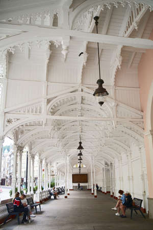 KARLOVY VARY, CZECH REPUBLIC - AUGUST 20, 2021: White wooden Market colonnade or Trzni kolonada in the spa town of Carlsbad