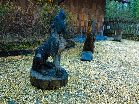 Sculpture in wood carved figurine wolf grey black dark wildpark zoo animal wild life