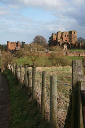 View of a castle over a fence - narrow depth of field photo