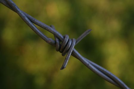 Barbed wire diagonally across the picture photo
