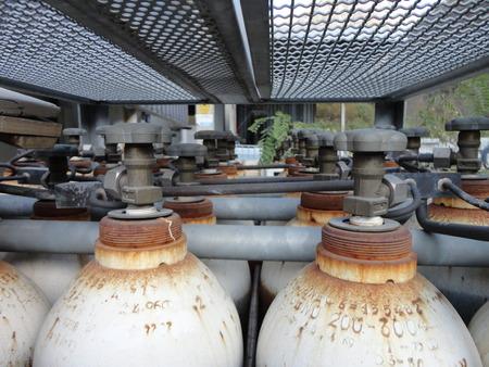 Bottled Valves of an industrial stock of used bottledcylinders photo
