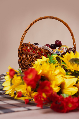 flowers and berries in a basket