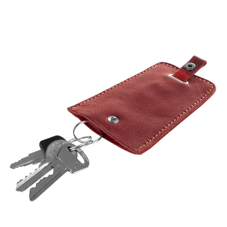 Simple red leather key holder with three keys isolated on white background