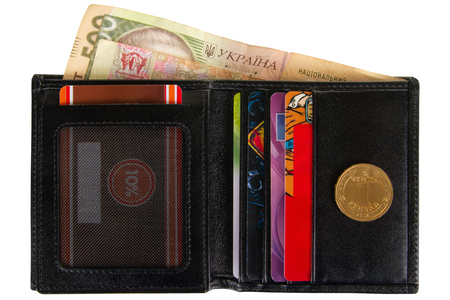 Open black leather wallet filled with paper and metal hryvnia isolated on white background Banco de Imagens - 124929106