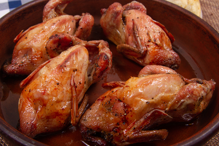 Roasted pigeon  with Golden brown crispy crust. Close-up. Banco de Imagens