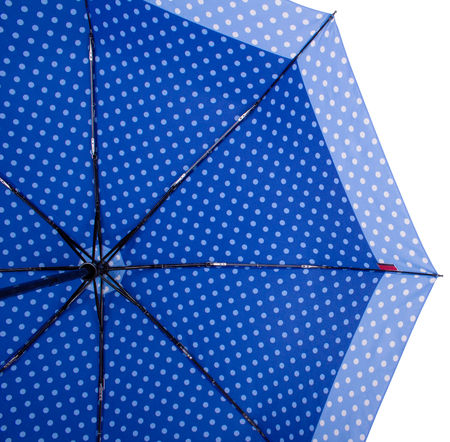Underside of Blue Dotted umbrella with eight ribs isolated on white background. Bottom view