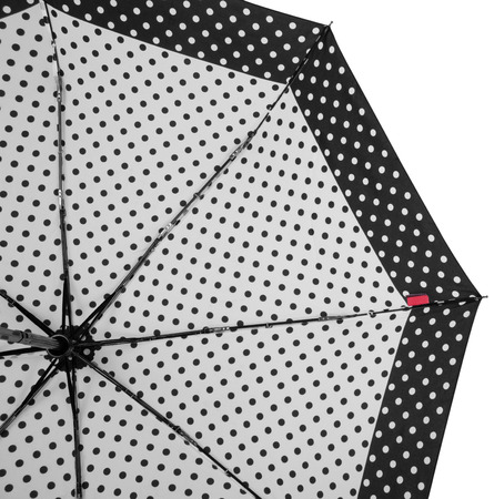 Underside of Black and white Dotted umbrella with eight ribs isolated on white background. Bottom view Banco de Imagens - 124929484