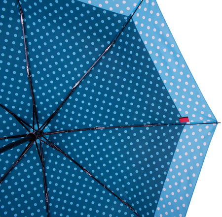 Underside of Steelblue color Dotted umbrella with eight ribs isolated on white background. Bottom view Banco de Imagens - 124929492